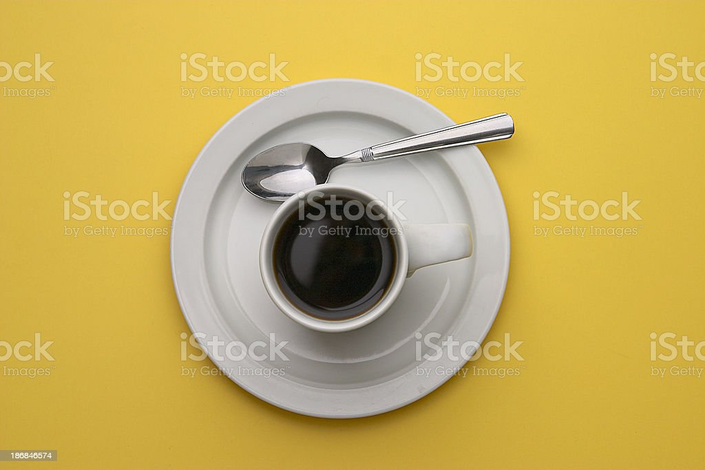 Coffee with Spoon on Yellow royalty-free stock photo