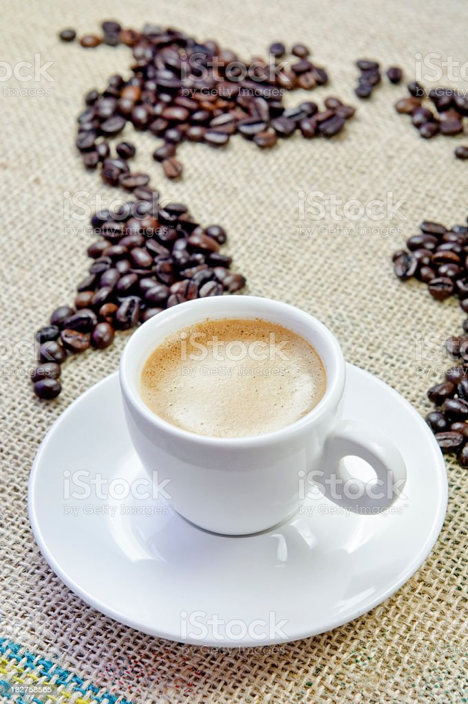 Coffee world map and a cup of espresso royalty-free stock photo