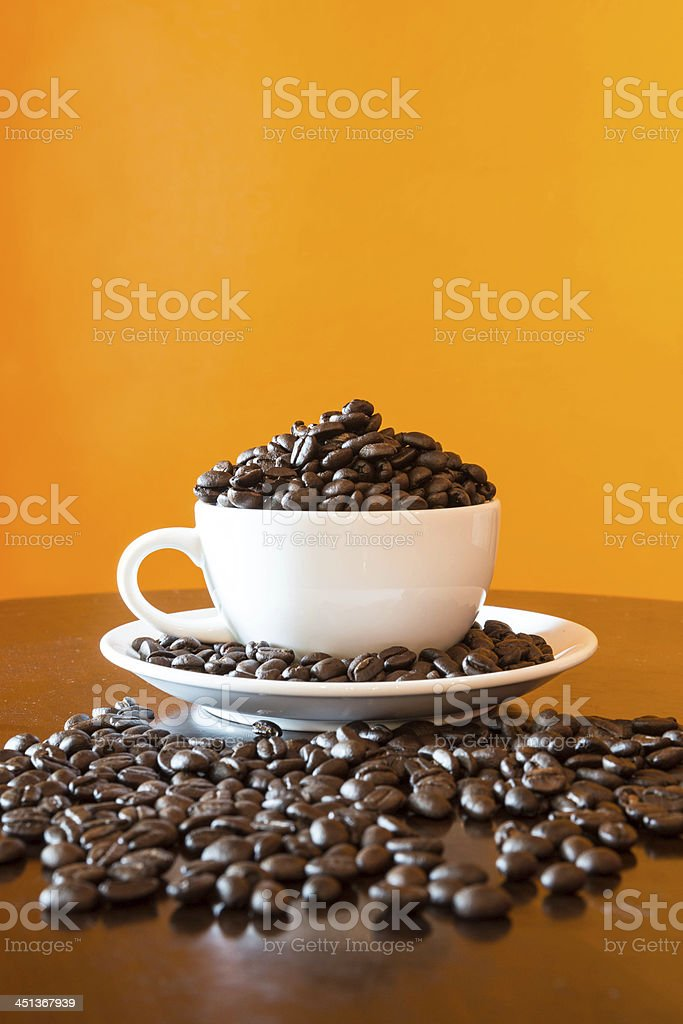 coffee-bean in cup stock photo