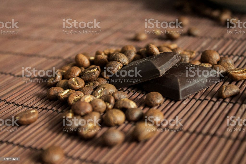 Coffeebeans and chocolate bars on striped background stock photo