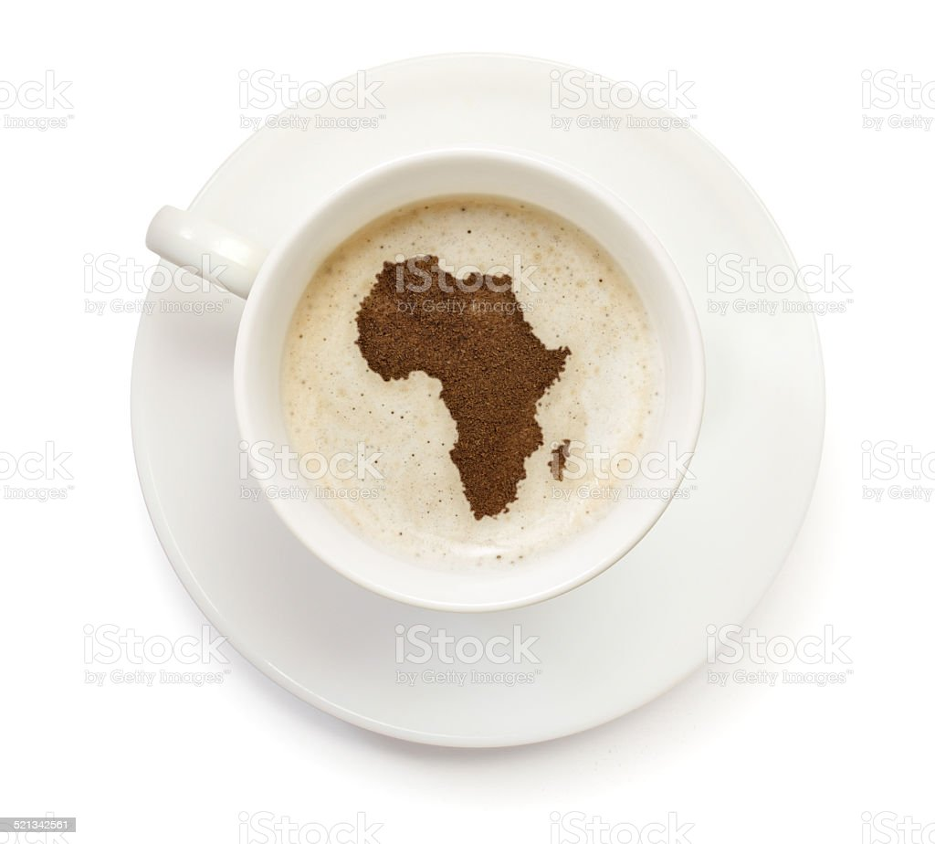 Coffeecup with powder in the shape of Africa stock photo