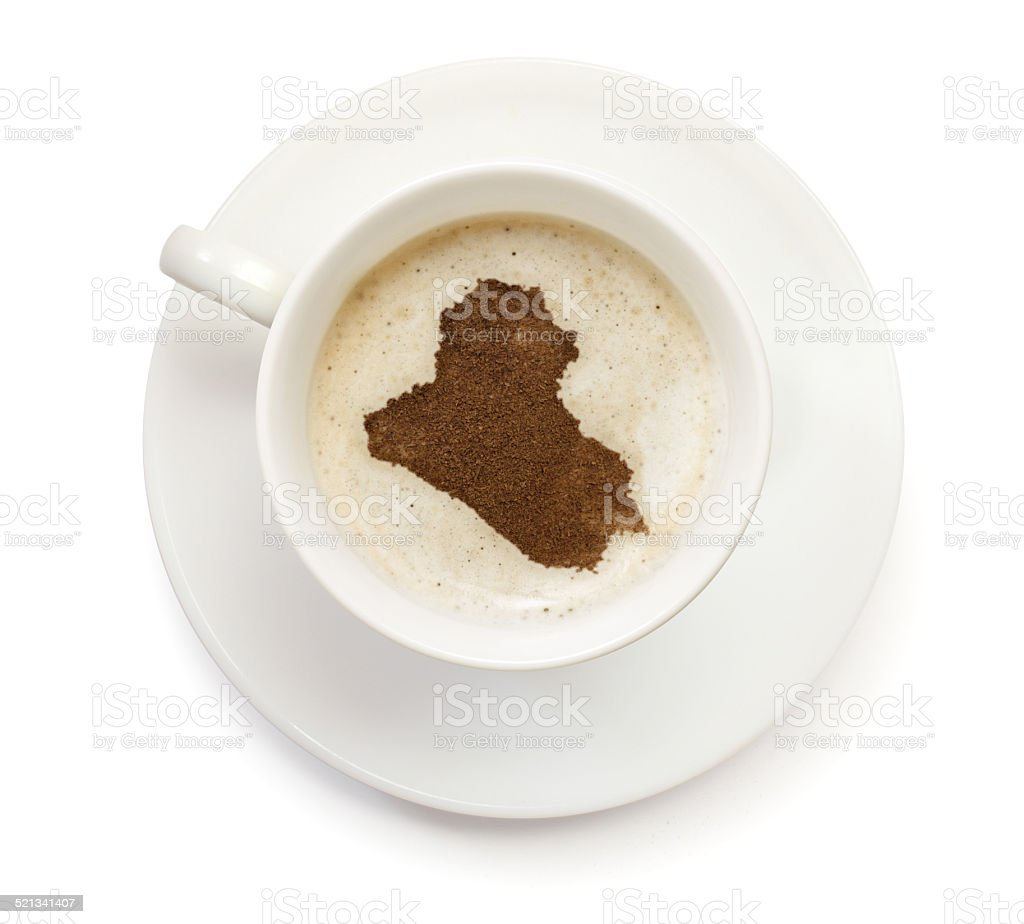 Coffeecup with powder in the shape of Iraq stock photo
