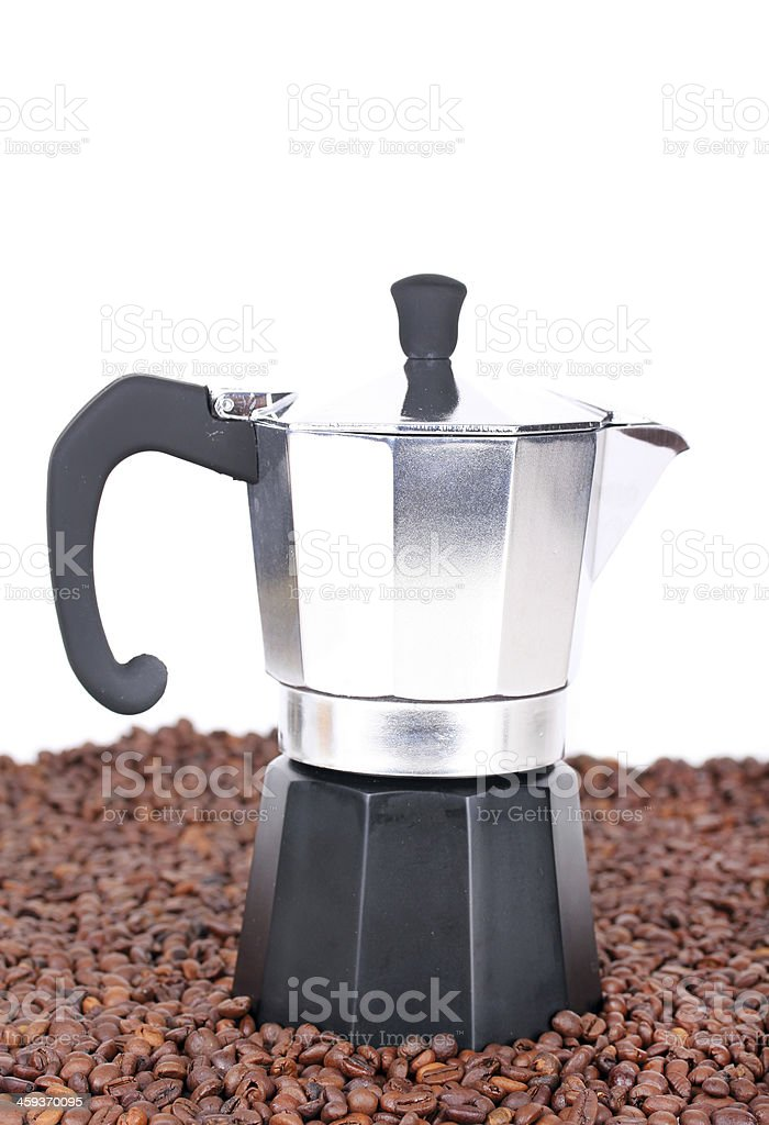 Coffeepot on coffee beans stock photo