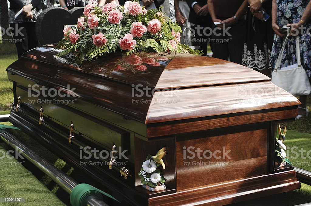 Coffin at a funeral service in a cemetery stock photo