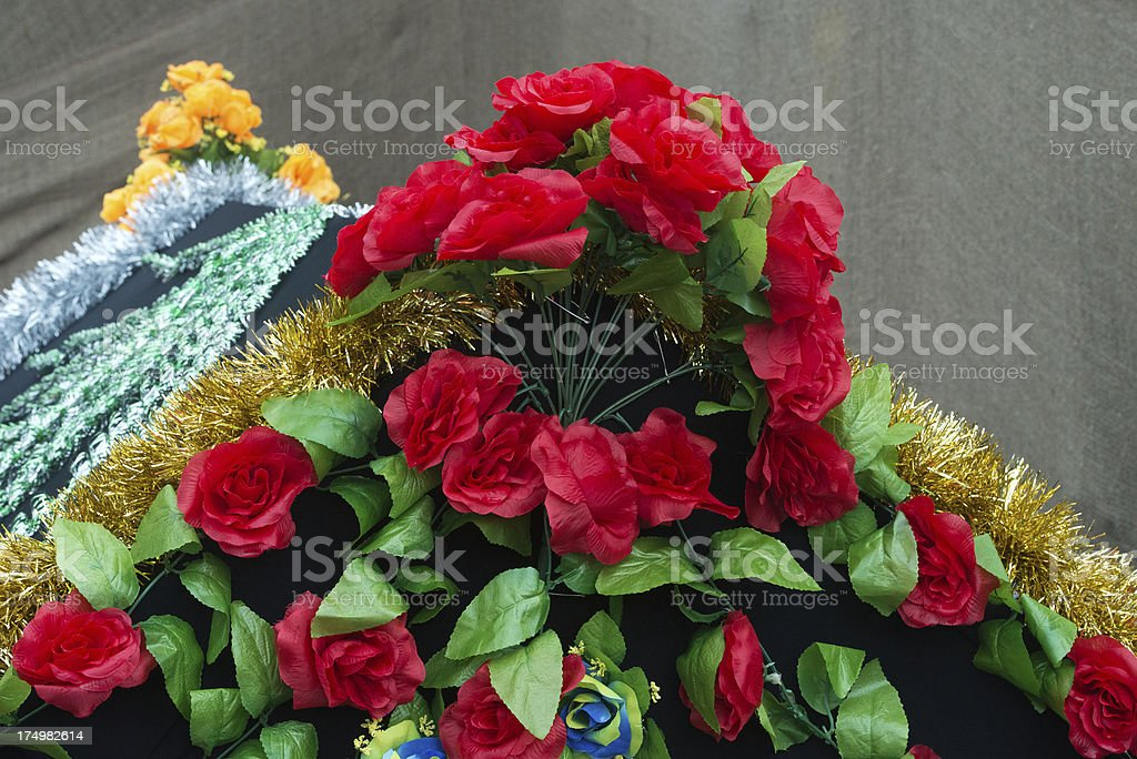 Coffin covered with flowers royalty-free stock photo