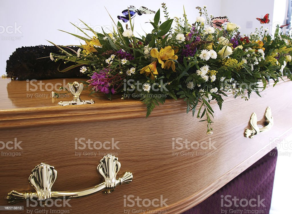 Coffin decorated with flowers stock photo