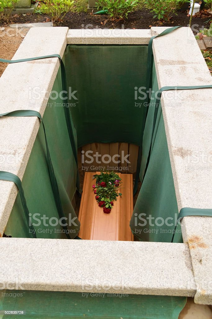 Coffin in the ground stock photo