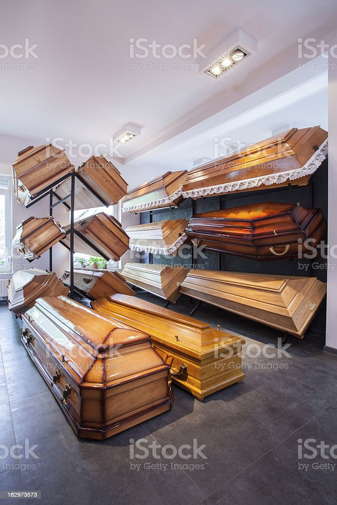 Coffins in funeral home stock photo