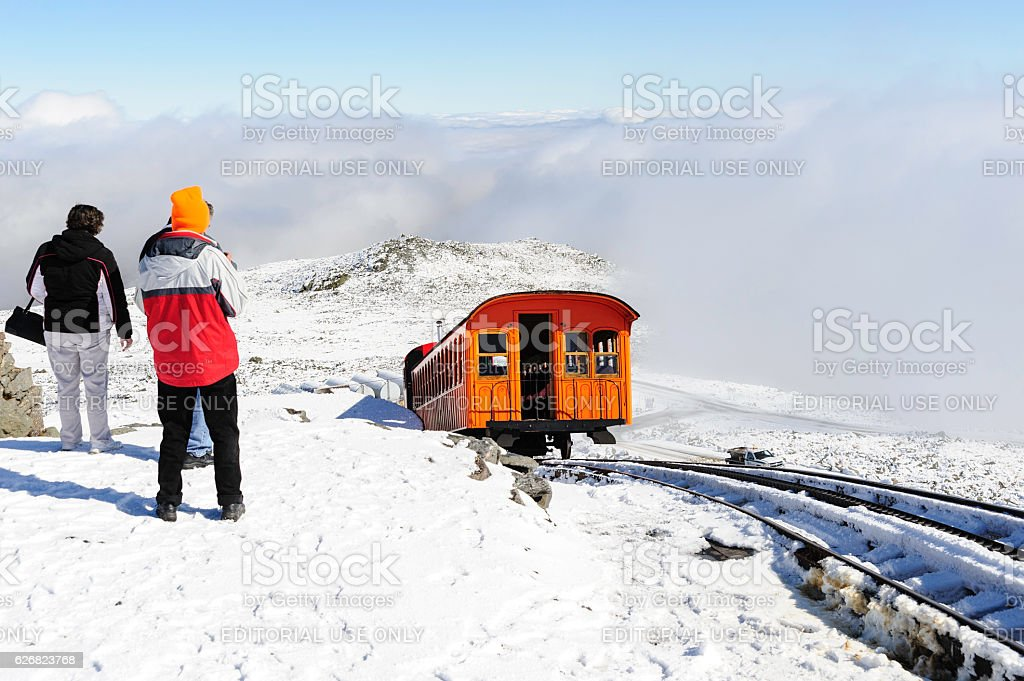 Cog Railway train leaving summit stock photo