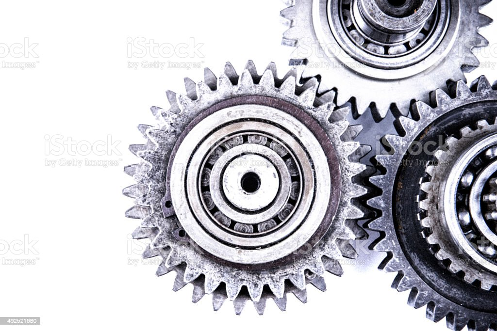 Cog wheels, gears, machine teeth and transmission on isolated background stock photo