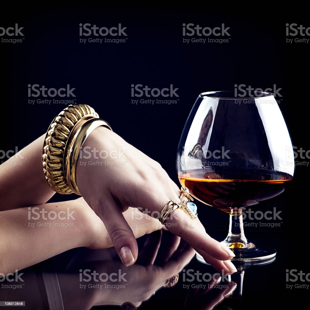 Cognac and jewelry stock photo