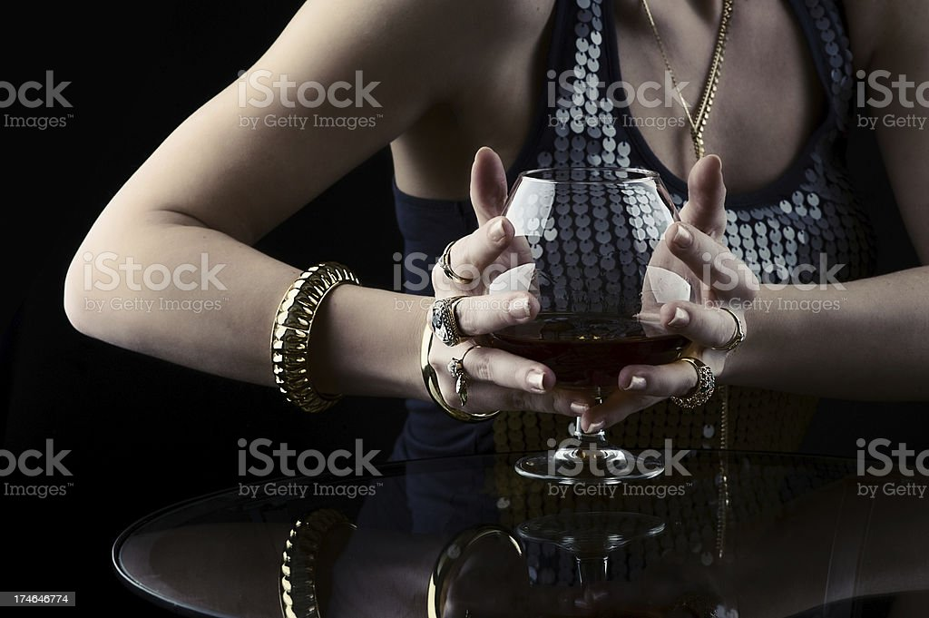 Cognac and jewelry royalty-free stock photo