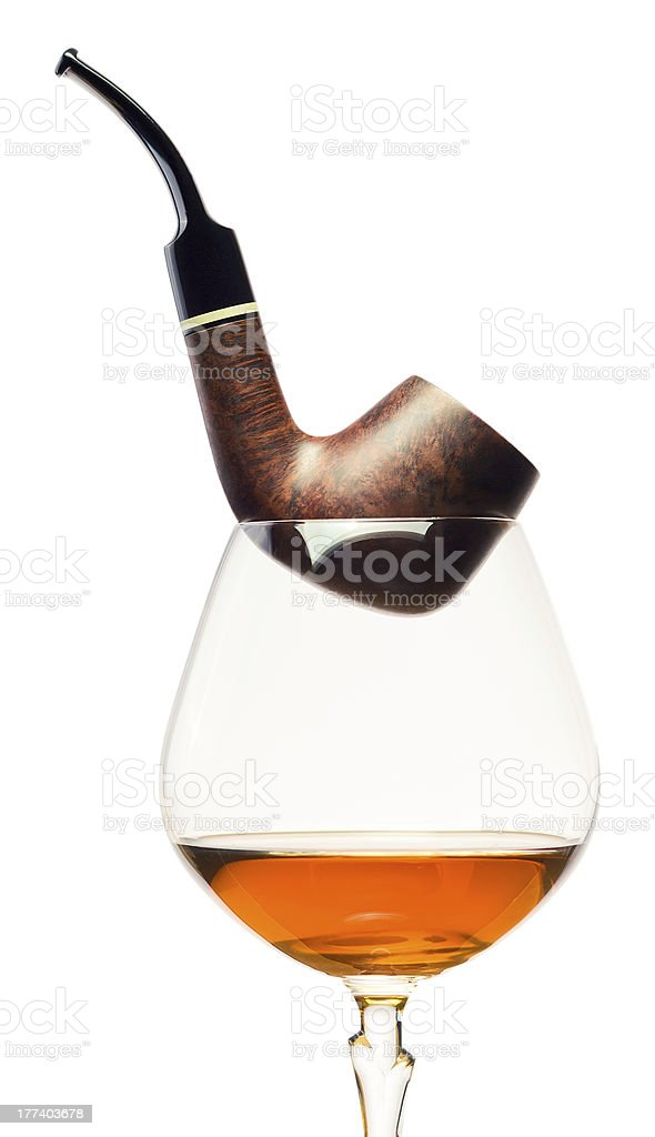 cognac and pipe on white background royalty-free stock photo