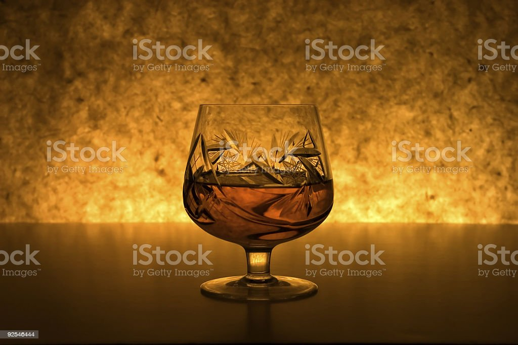 Cognac by the fire stock photo