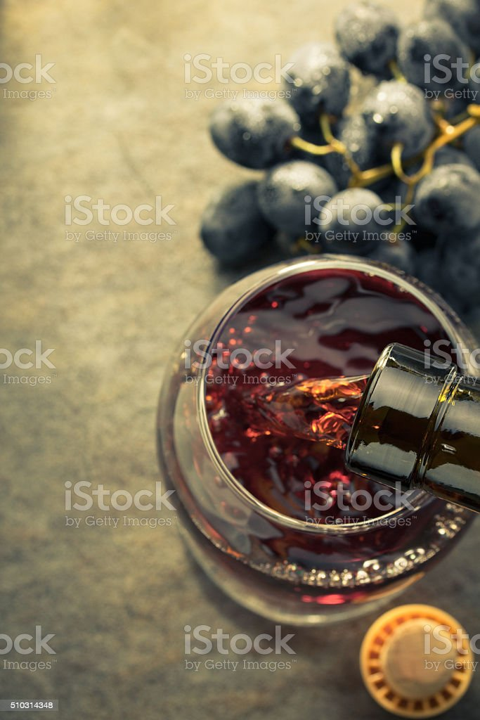 cognac glass and grapes stock photo