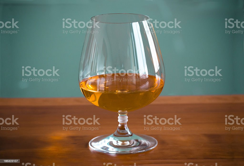 Cognac Glass on Bar Counter royalty-free stock photo