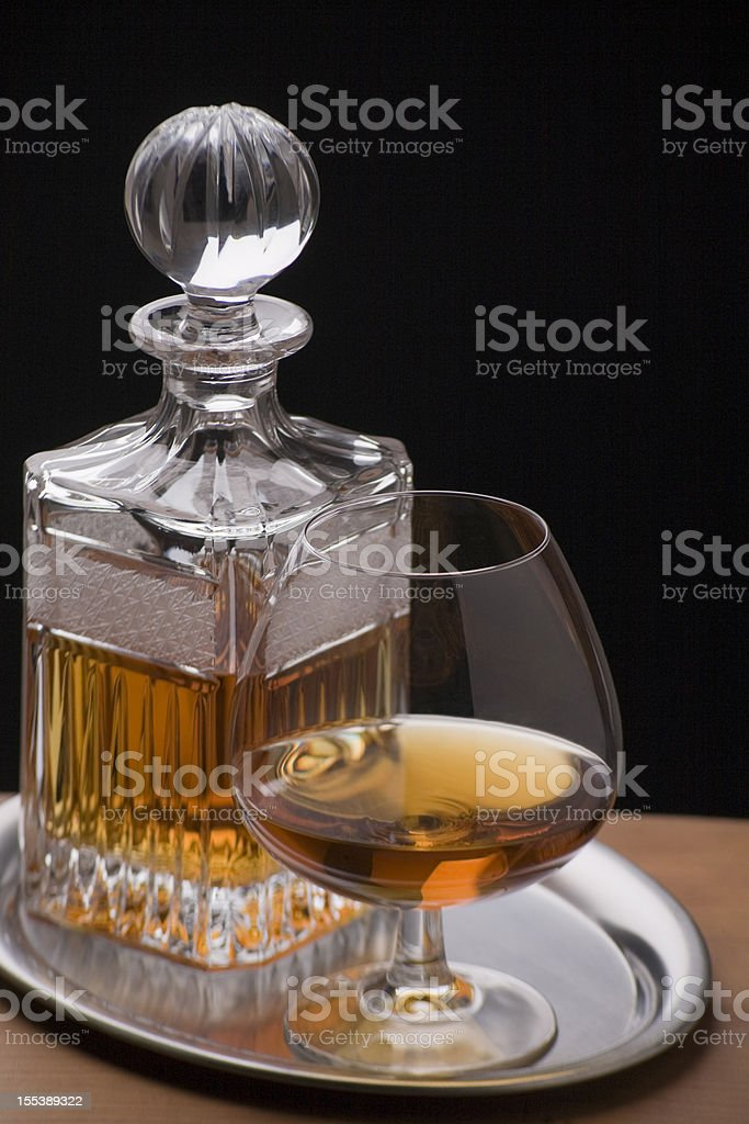 Cognac glass with decanter royalty-free stock photo