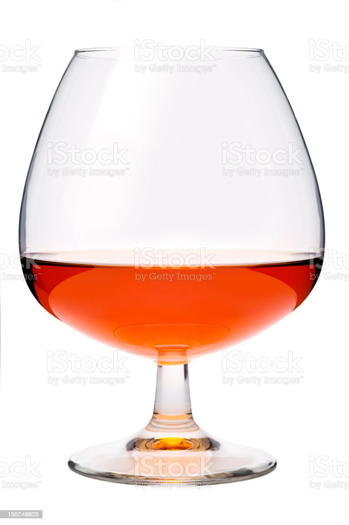 Cognac in a glass, isolated, white background stock photo