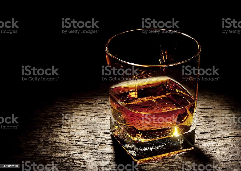 Cognac in a square glass stock photo