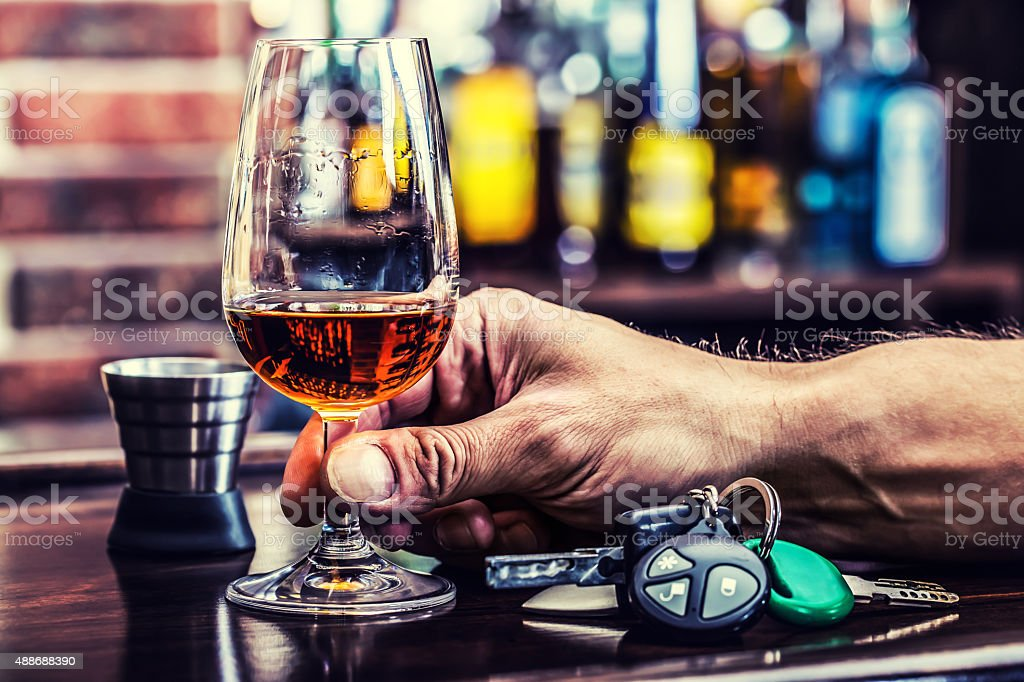 Cognac or brandy hand man the keys to the car stock photo