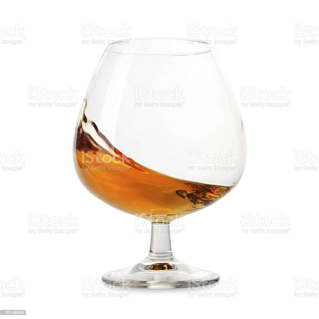 Cognac splashes in a glass stock photo