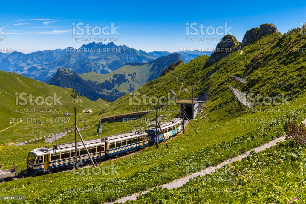 Cogwheel train running to Rochers-de-Naye stock photo
