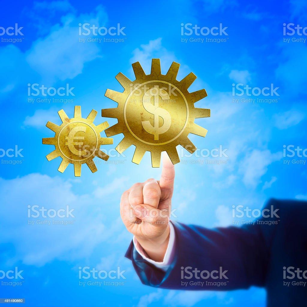 Cogwheel With Dollar And Euro Sign Interlocking stock photo