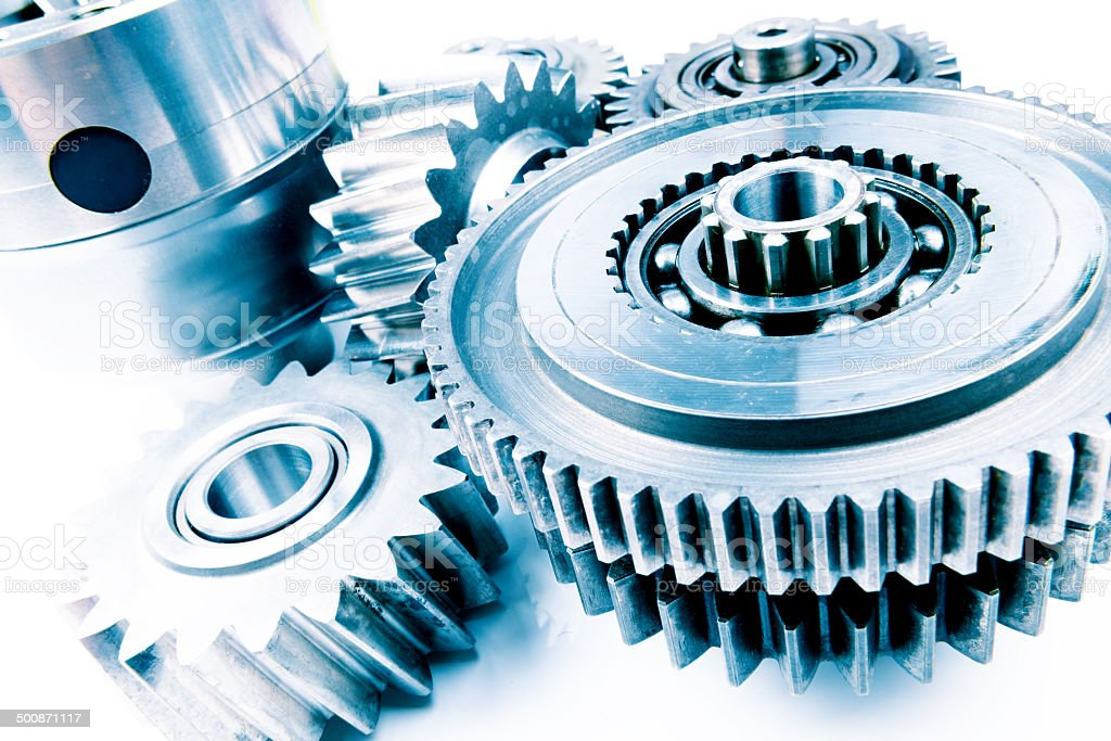Cogwheels, gears and machine teeth in teamwork concept photo stock photo