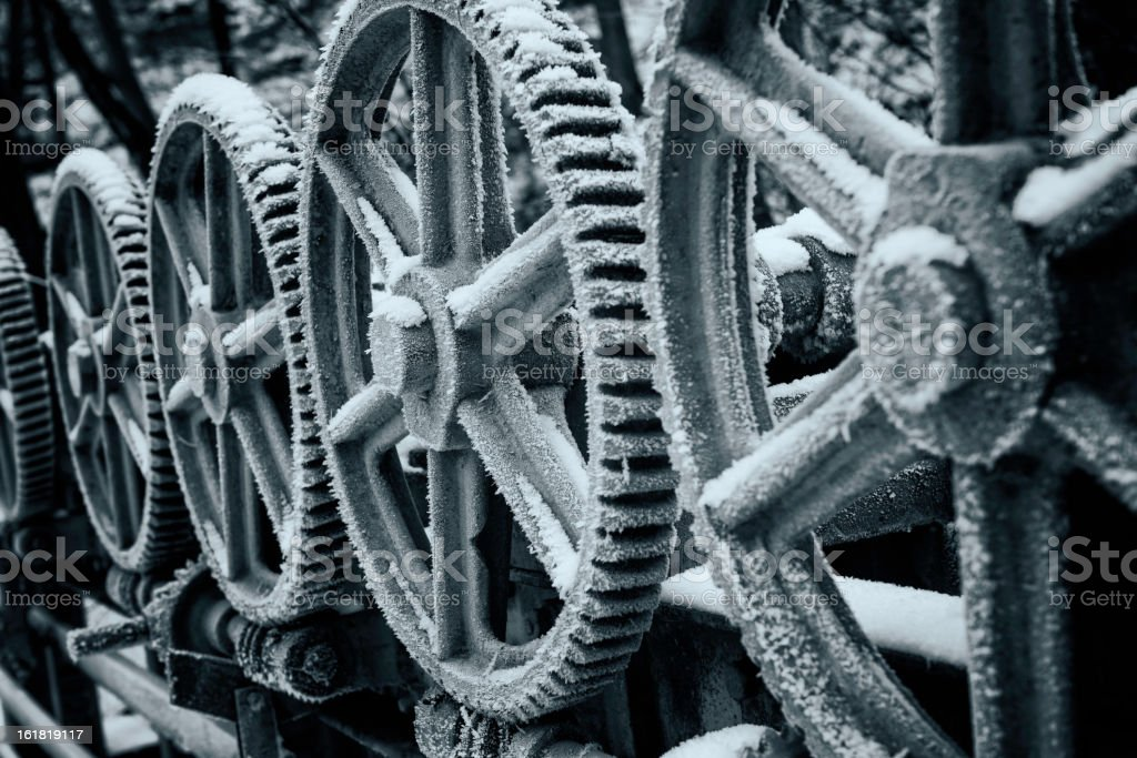 Cogwheels with frost and snow royalty-free stock photo
