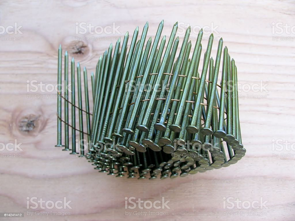 Coil nails in roll for nailer guns stock photo