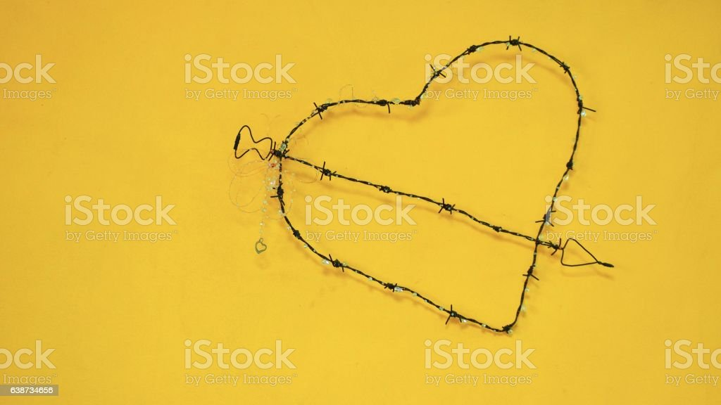 Coiled barbed wire heart stock photo