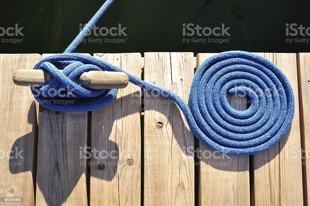 Coiled Blue Rope and Cleat stock photo