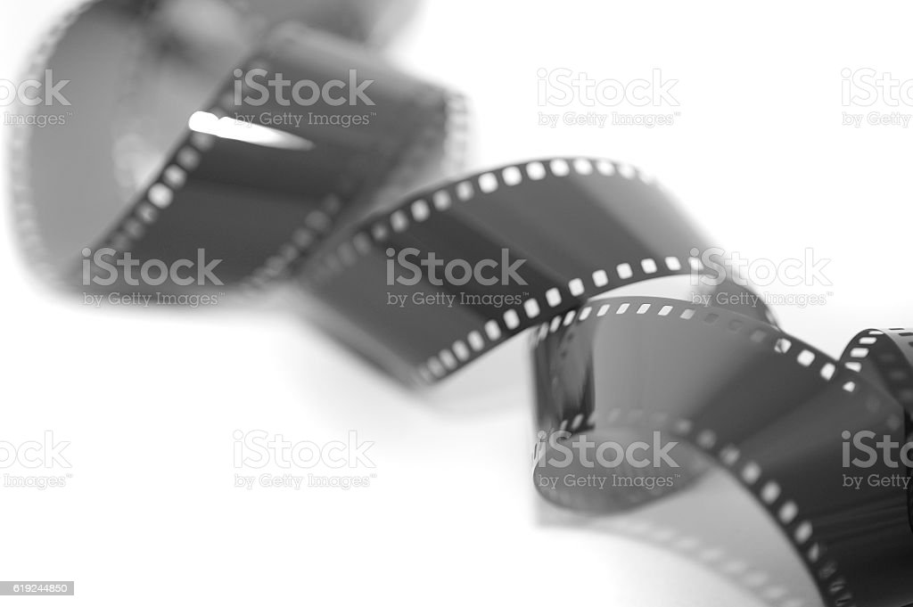 Coiled exposed 35 mm film strip stock photo