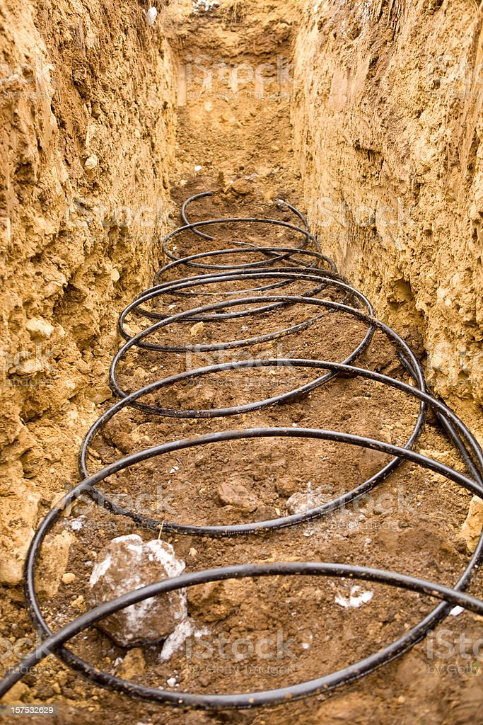 Coiled Geothermal Pipe in an Underground Trench stock photo