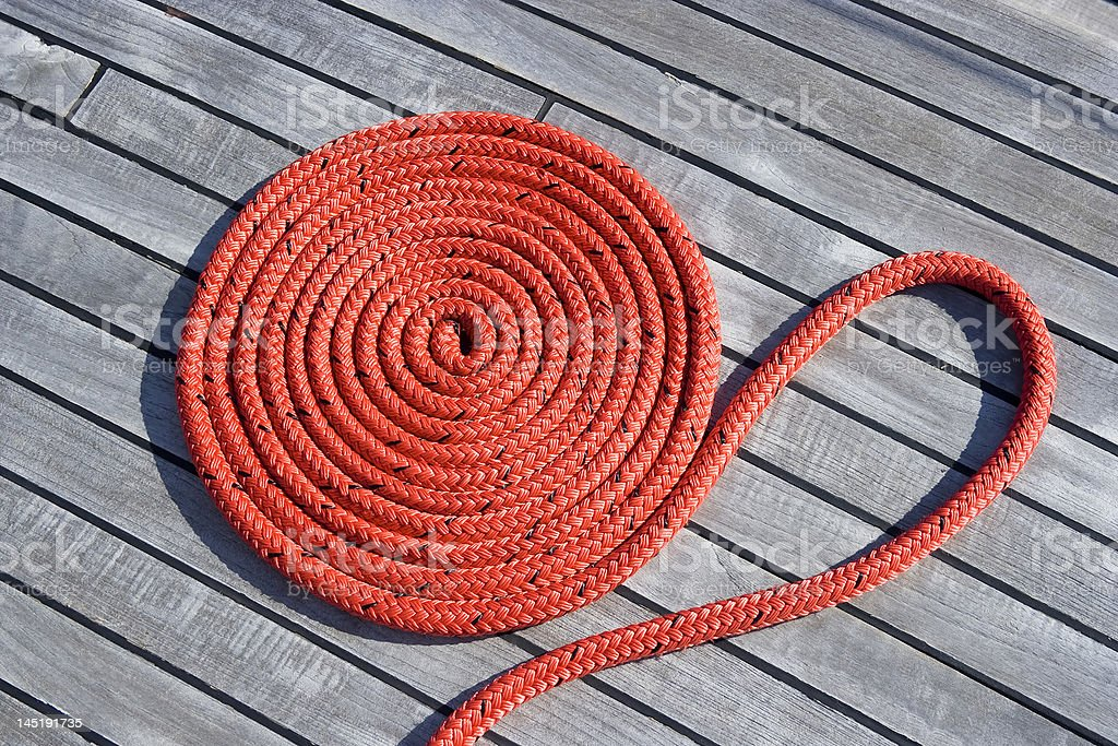 Coiled rope on the deck. royalty-free stock photo