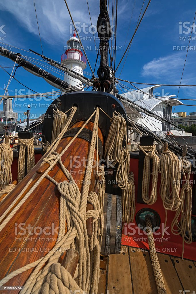 Coiled ropes, bowsprit at foredeck of Tall Ship HMB Endeavour stock photo