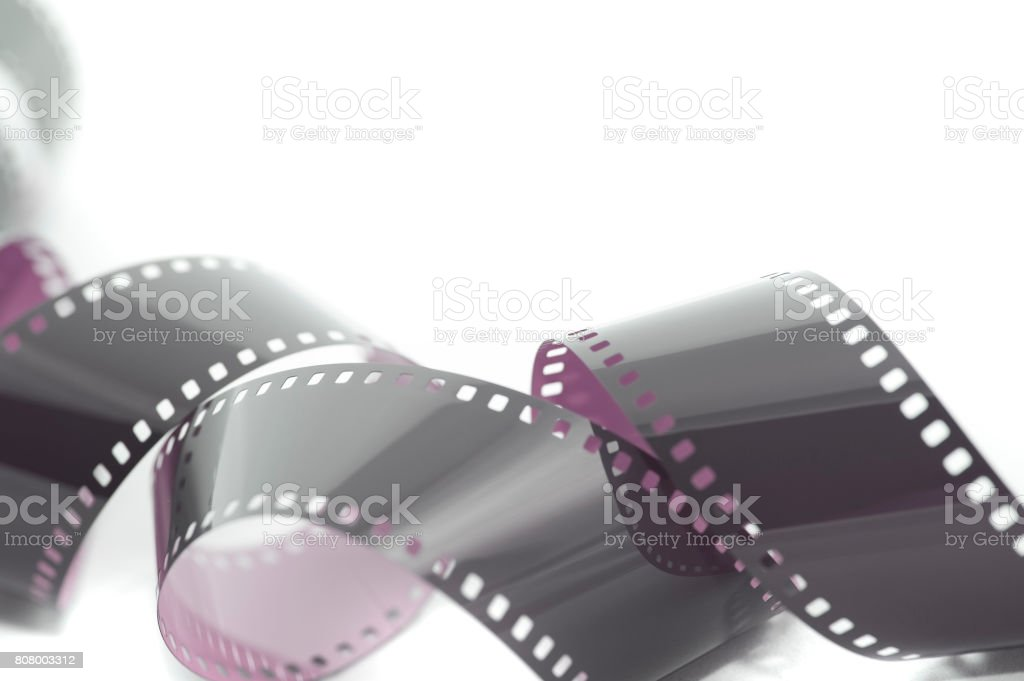 Coiled unrolled exposed 35mm film strip stock photo
