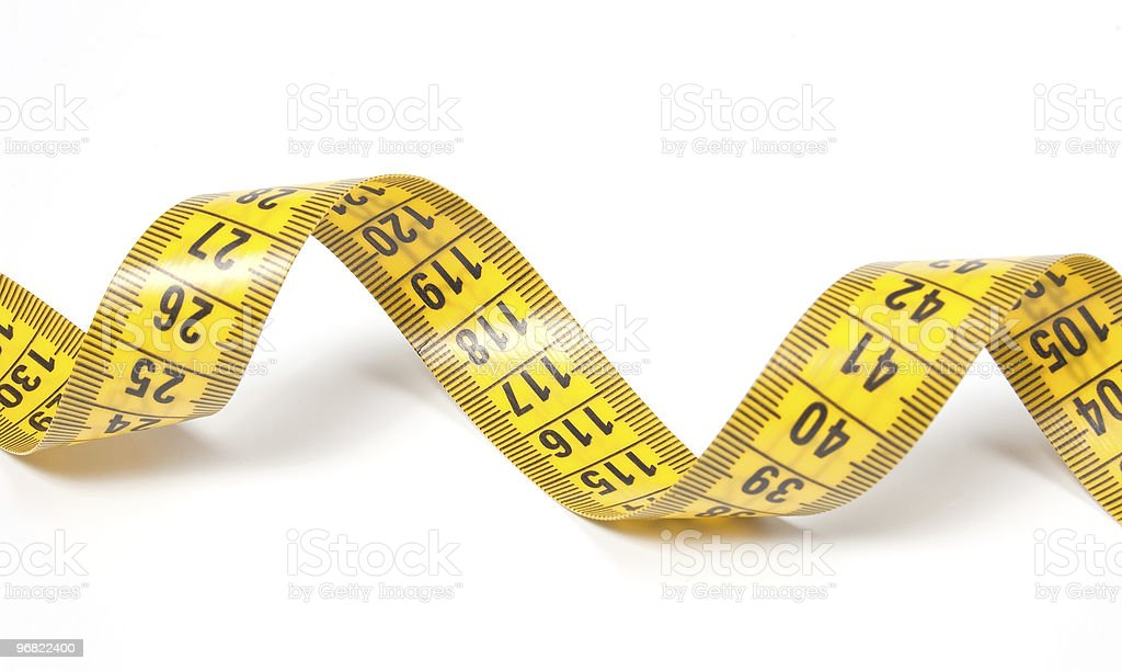 Coiled yellow measuring tape isolated on white stock photo