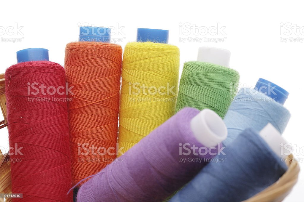 Coils from a thread of different colors in  basket royalty-free stock photo
