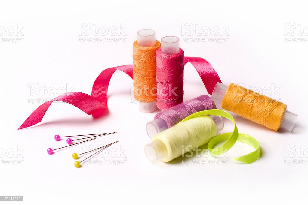 Coils of threads in different colors on white background stock photo