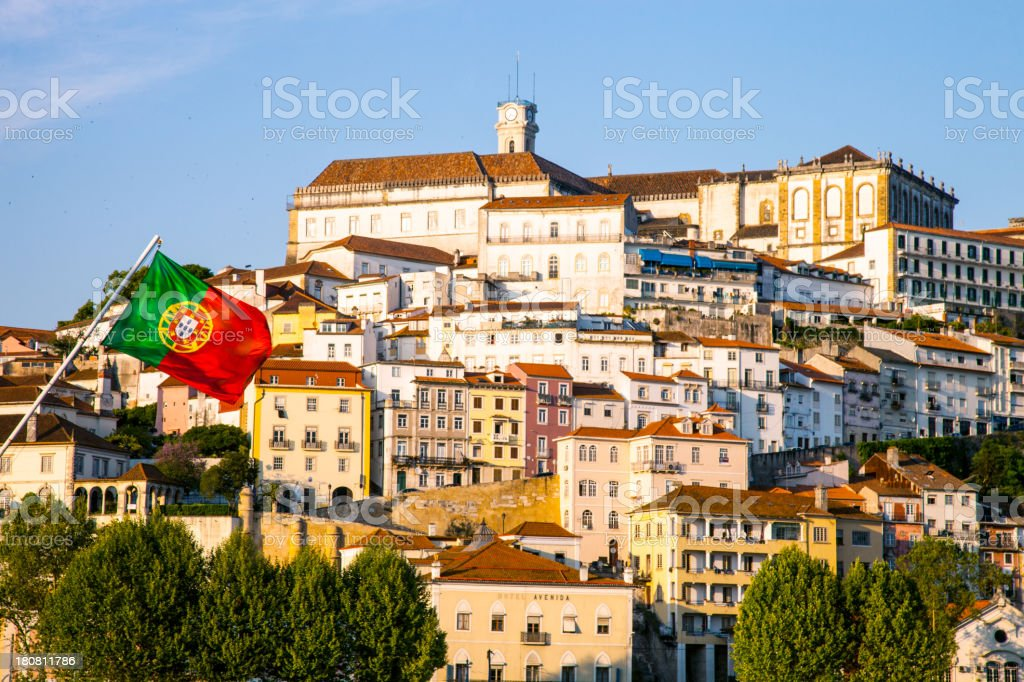 Coimbra old town and Portugal flag seen from the river royalty-free stock photo
