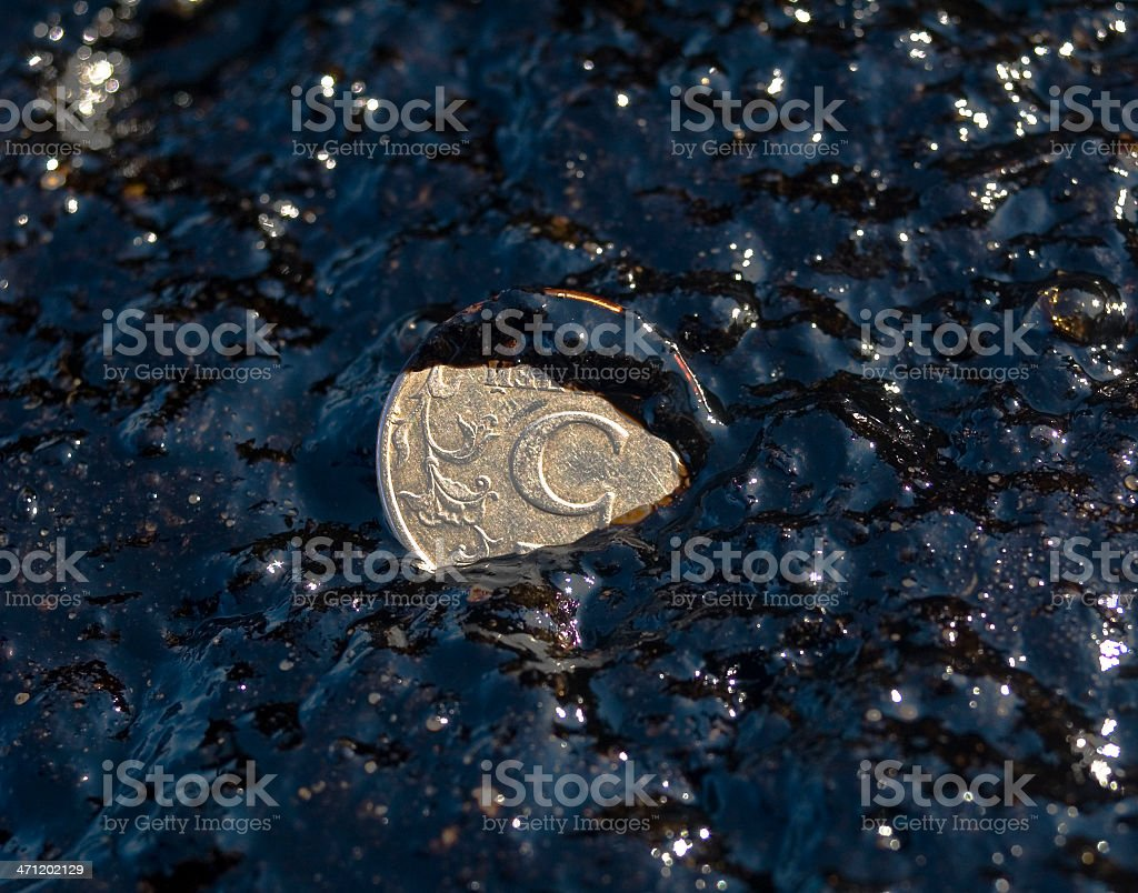 Coin 5 (five) rubles in oil liquid royalty-free stock photo