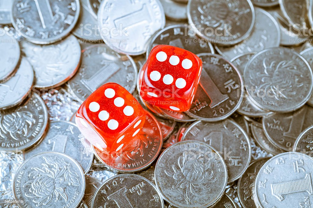 coin background with dices on it stock photo