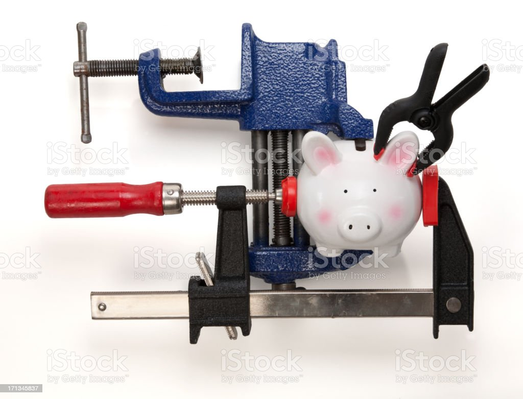 Coin Bank held in place with vice grips and clamps stock photo