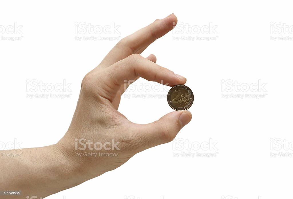 Coin in a hand stock photo