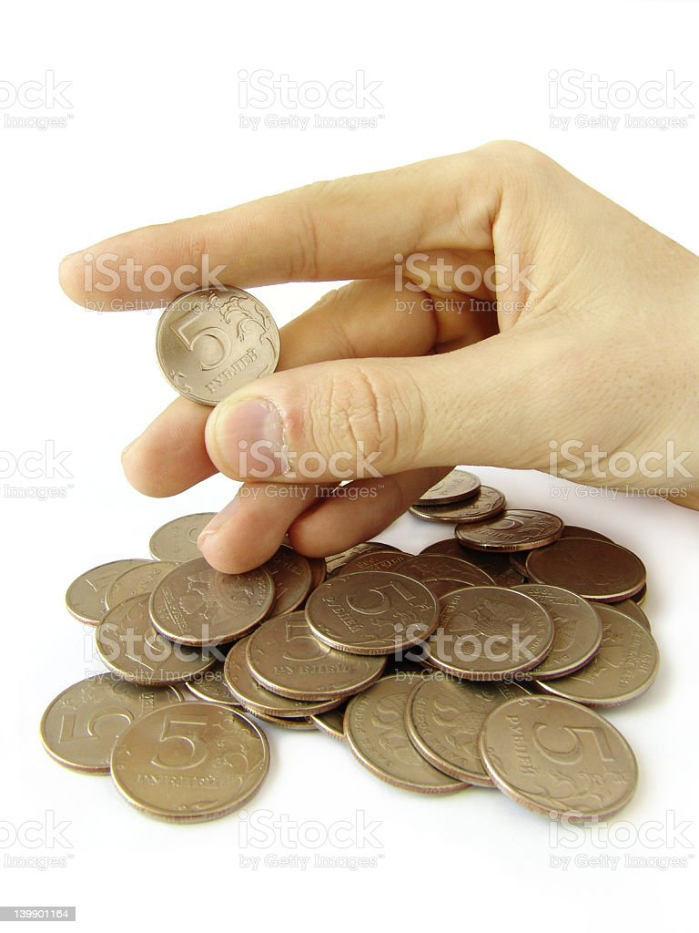 Coin in fingers royalty-free stock photo