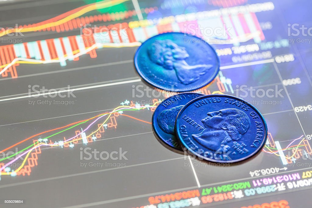 coin in the stock data graph stock photo