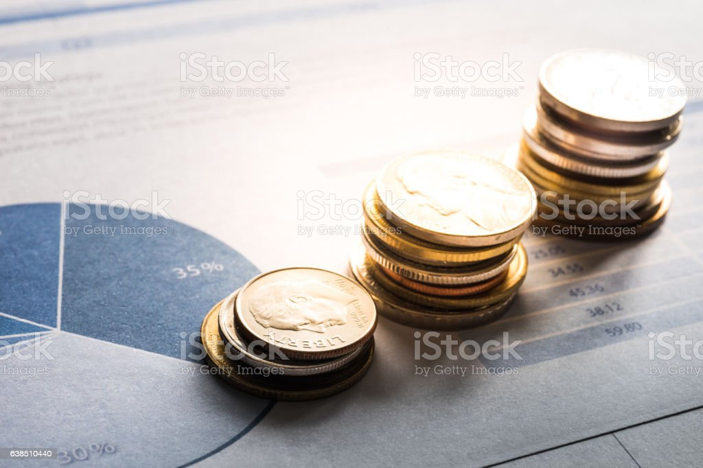Coin money stacked growing on document graph.financial concept stock photo