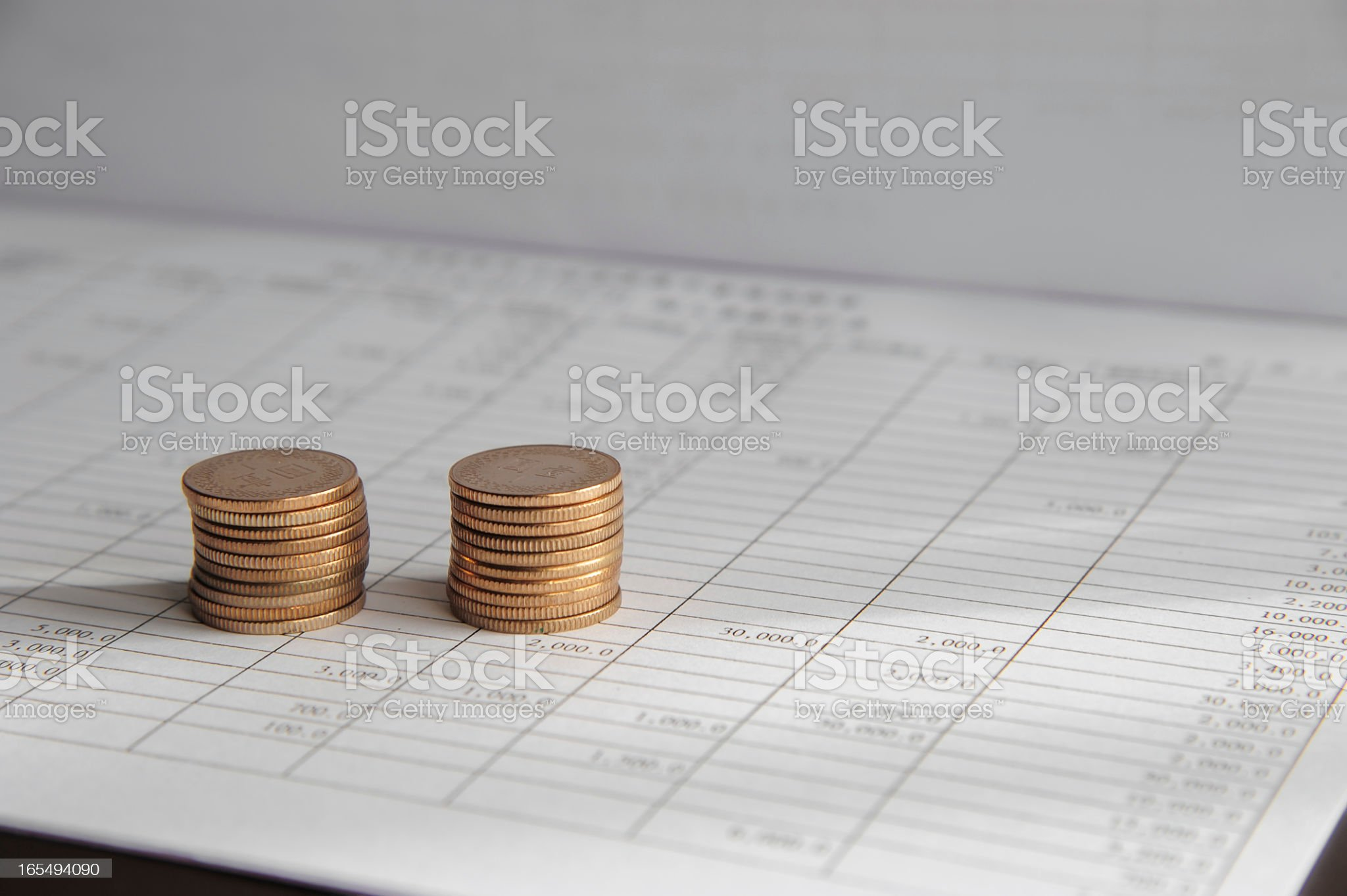 Coin on Business Paper royalty-free stock photo