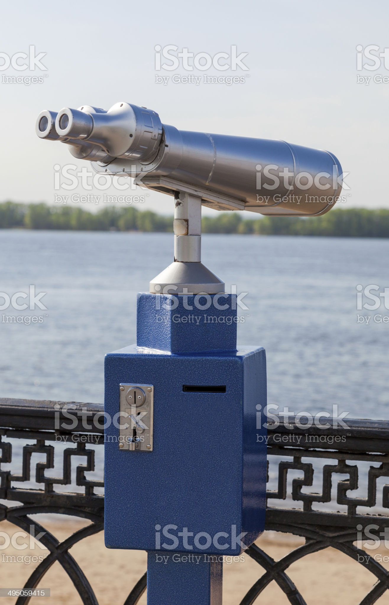 Coin operated binocular on the bank of river royalty-free stock photo